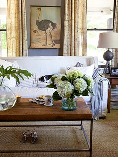 Texture! Love this living room coffee table's reclaimed wood, nubby sea-grass rug, a steel lamp base.