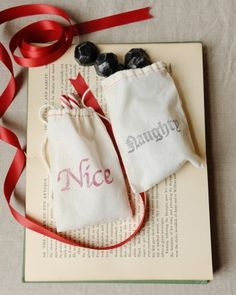 """Naughty"" or ""nice"" bags filled with chocolate ""coal"" and peppermint sticks as holiday wedding favors"