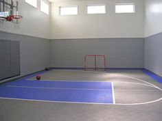 Utah house that has an indoor tennis court interior for Building a half court basketball court