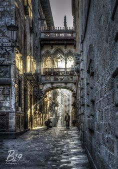 The Gothic Quarter in barcelona and a much photographed arch.