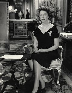 The Queen delivers her 1960 Christmas Broadcast from Buckingham Palace at 3.00pm, chosen as the best hour for reaching most of the countries in the Empire by short waves from the radio transmitters in Britain. The event called for demure, classic, off-shoulder black and a sparkling brooch.