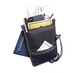 Neck/Waist Safe | Travel organizer can be worn around your neck or waist thanks to the adjustable elastic strap. Four pockets for passport, id, cash and coins. Center pocket opens to hold boarding pass, glasses, pen and cell phone. Wear under or over clothes. Neoprene. Shop at SkyMall.com!