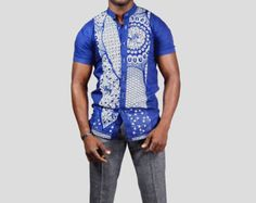 African shirt- African style men's shirt. Shop mmExclusives African Inspired Fashion Collections  #Africanfashion #GQ #mensstyle #dapper #mensfashion #mensuit #africansuit #africanblazer #ankara #ankarastyle #africanstylefashion #tie #pocketsquare #shopping #clothing #necktie #pants