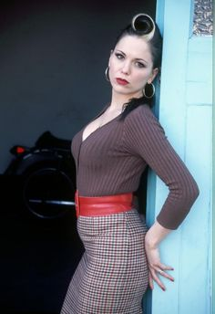 Imelda May - completely dominates muted tones in clothes with her Bright Winter colouring in skin, hair, eyes.