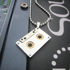 Stainless Steel 2-tone Audio Tape Charm Pendant -This is a great replica stainless steel pendant of the cassette audio era. Available from Music Jewellery Online and totally customisable.  http://www.musicjewelleryonline.uk/product/audio-tape-pendant-2-tone-stainless-steel?tid=42