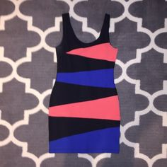 Pink,blue,&black tight mini dress! Worn once, great fit, is firm, but stretches, material is amazing, super comfortable, zips in back, size medium, but can fit a small too! Blue and pink are bright but not too obnoxious, worn only once, no flaws! Boutique brand, posting for views, make me an offer  Urban Outfitters Dresses Mini