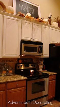 Adventures in Decorating: 2011 Fall kitchen-above cabinet decor Above Kitchen Cabinets, Decor, Home Kitchens, Sweet Home, Kitchen Decor, Fall Kitchen, Above Cabinet Decor, Kitchen Cabinets Decor, Home Decor
