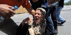 Protesters pour water on a woman's head after she fell to the ground on June 2013 during clashes with riot police against the demolition of Taksim Gezi Park in Istanbul Riot Police, Time Magazine, Revolutionaries, Human Rights, Istanbul, Bbc, Park, Turkey, Revolutions