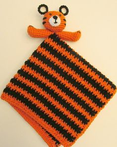 Isn't this little lovey adorable?? And it is so easy to make too!This pattern is easy, and is written in american terms.Materials Worsted weight yarn in orange, black and small amount of white 4mm hook 5mm hook Yarn needle Fibrefill or yarn scraps to stuff 2 6mm safety eyes or alternativeAbbreviations Ch = Chain Dc = Double crochet Hk = Hook Invscdec(s) = Invisible single crochet decrease(s) Sc = Single crochet Sl st = Slip stitch St(s) = Stitch...