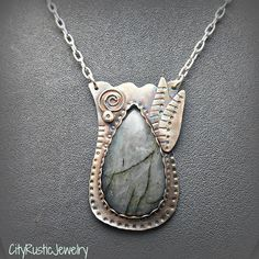 Sterling Silver Tulip Blossom Pendant with Teardrop Labradorite Stone Cabochon D by CityRusticJewelry on Etsy https://www.etsy.com/listing/228311954/sterling-silver-tulip-blossom-pendant