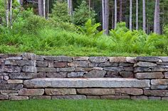 Dry-laid masonry walls, using locally reclaimed granite, give definition to the steeply sloped property while also helping to stem erosion by slowing water runoff.