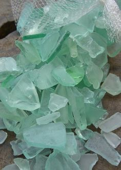seaglass vase filler...would be great for anchoring candles on the tables or as a base for place cards