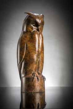 Captured in a moment of repose, this bronze bird sculpture of an Eagle Owl reflects the beauty of this magnificent bird. The deep blacks and reddish browns of the boldly executed patination further deepens the mystery of this nocturnal bird of prey. Released in an edition of twelve.