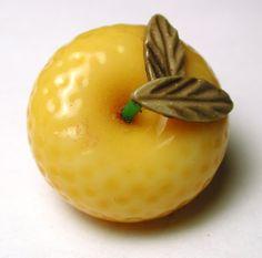 ButtonArtMuseum.com - Vintage Weeber Celluloid Button Realistic Orange Design So Charming