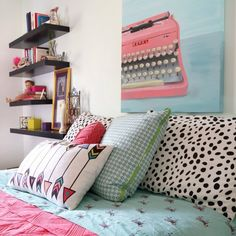 This girls bedroom makeover in aqua and coral creates a grown up space for a maturing teen girl.