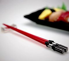 Don't stop to think about how difficult (not to mention dangerous) it would be to eat with these if they were actual light sabers.