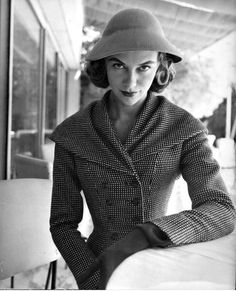 Model in small check, fitted jacket with shawl collar by Ferdinandi, Italy, 1954