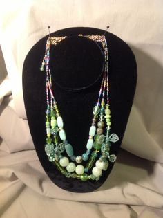"""""""Shades of Green"""" Swarovski crystals, Delica's, Glass, Semi-precious stones, combined into an eclectic delight! Truly unique, one of kind, by: gracebeadeddesign@gmail.com"""