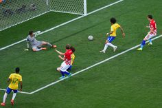 Nikica Jelavic and Ivan Perisic celebrate as Julio Cesar, David Luiz and Marcelo watch a deflected shot cross the goal line during the 2014 FIFA World Cup group A match between Brazil and Croatia at Arena Corinthians on June 12, 2014 in Sao Paulo, Brazil.