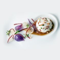Poached duck egg with roasted onion consommé, lemon thyme and smoked duck by chef Simon Hulstone of The Elephant restaurant from Torquay,UK