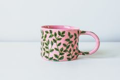 This mug has been handcrafted from smooth white stoneware, painted with food safe underglazes and fired to high temperatures. It is glazed entirely apart from the base. You will receive one Vine On Pink Mug, similar to the one shown. Each mug is made to order and unique. Please allow up to