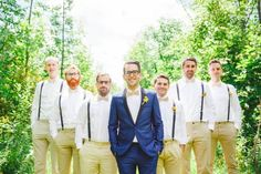 Bold blue for the groom, khaki & suspenders for the groomsmen | Image by Magnolia Studios