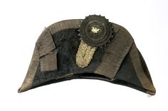Chapeau bras, belonging to Caleb S. Woodhull (1792-1866), possibly worn during the War of 1812.  Beaver skin, textile, leather, braid, metal, manufactured by Tweedy & Benedict, 37 Maiden Lane.  Gift of Mr. Leslie A. Davis.  NYHS Object Number 1952.325a.