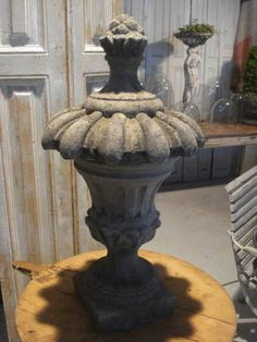 A pair of antique sandstone finials carved as stylised pine cones