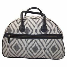"""Hand-woven cotton weekender bag with leather handles and an ikat diamond motif. Made by artisans in India.  Product: Weekender bagConstruction Material: Cotton and leatherColor: Black, grey and ivoryFeatures:  Front zipper and small interior zipper pocketBrass grommets on base to protect bottom of bagHandmade by a fair trade-certified artisan group in India24"""" Handles Dimensions: 13"""" H x 20"""" W x 10"""" DNote: Due to the nature of handmade textiles, color may vary and slight imperfections may…"""