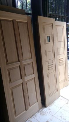 Modern minimalis wooden door (right), classic wooden door (left).