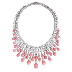 This one-off necklace by David Morris is set with 30 soft pink conch pearls weighing a combined 102.47 carats, which display the distinctive flame-like structure that is associated with the finest conch pearls (POA).