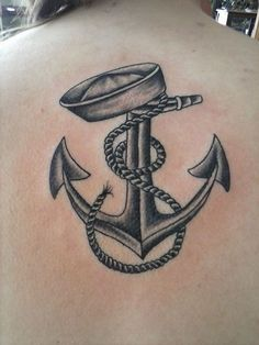 Black and grey navy anchor on back.