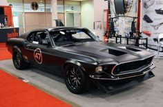 1969 Mustang Restomod - I tend to like my muscle cars a little more stock, but I can't pass up pinning a 69 Mach 1, so here it is. What do you think? I'd like to see what the engine compartment looks like under that hood.