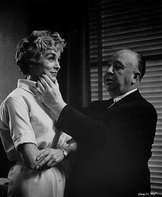 """Alfred Hitchcock grabs Janet Leigh's face on the set of """"Psycho"""" 