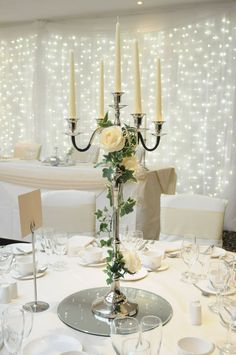 Wedding Table Candelabra Centerpiece - While looking for the most memorable wedding dining ideas, you should keep four thi Candleabra Wedding Centerpieces, Candelabra Flowers, Candlestick Centerpiece, Wedding Table Centerpieces, Flower Centerpieces, Wedding Decorations, Wedding Candelabra, Silver Candelabra, Diy Wedding
