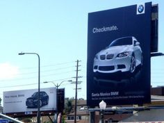 LOVE this ad campaign.    (pay attention to the word on the BMW board and the other billboard in the distance)