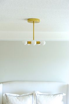 """SMALL 5 SOCKET BRASS PINWHEEL  Add this fun light to any small space for a little charm. Perfect for an entryway or nursery  This clean design spreads light to all corners of the room while fitting snug up against the ceiling, perfect for low ceiling heights  Pictures shown with 8"""" dropper rod and G16.5 Candelabra globe bulbs  DIMENSIONS: • 6.5""""W x 6.5""""L • Canopy diameter – 5""""  SPECS: • Solid brass materials • E-12 Candelabra Base sockets (bulbs not included) • All parts used are UL listed…"""