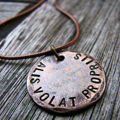 Alis Volat Propriis - She Flies With Her Own Wings Necklace via Etsy.