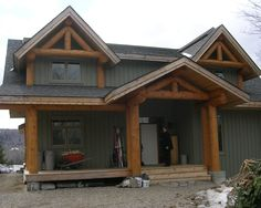 A conventionally built home with log and timber accents. #loghomes #loghomedesign #logconstruction #logaccents For more photos of this or more of my designs, please check out my website, www.designma.com, my Design Page, www.facebook.com/loghomedesign