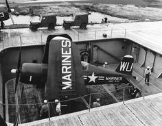 National Naval Aviation Museum picture of a F4U Corsair on the aircraft elevator.