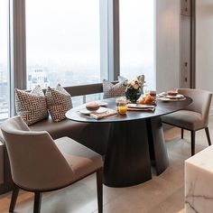 Dining room with a view by @powellandbonnell. #Fuego Oval dining table with a wood, solid surface or natural stone top,supported on a hand formed bisected elliptical steel cone base.  @south_hill_home . . . #PowellandBonnell #Fuego #DiningTable #DiningRoom #CustomDesign #InteriorDesign #Lighting #Textiles #Furniture #realestate #MadeinCanada #dreamhouse #homeimprovement #goals #inspo #decor #modelhome #gorgeous #inspiration #designers #contemporarydesign #residentialdesign #Toronto #home…