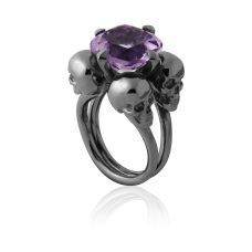 absolutely in love with this ring big ol amethyst with skulls around it