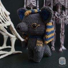 NOTE: This is a digital file of crochet pattern, NOT a finished toy A little Prince of Egypt, that's what people called him. Being born in the royal family, Anubis always gets whatever he wanted. But what interest him so much is the process of mummification! He often watches his father and his Amigurumi Patterns, Crochet Patterns, Aries Daily, Prince Of Egypt, Gold Embroidery, Anubis, Stitch Markers, Crochet Hooks, Cuddling