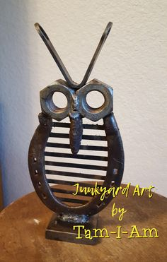 Junkyard Art by Tam-I-Am. Repurposed horseshoe, nuts, and wrench come together to make this owl. Scrap metal art.