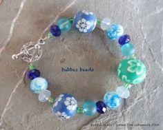 Polymer clay, crystal and glass bead bracelet.  www.facebook.com/bubbasbeads