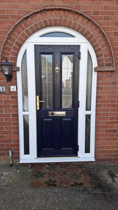 Blue composite front entrance door with white arched head upvc frame supplied and installed by Unicorn Windows Ltd of Leighton Buzzard, Bedfordshire Arched Front Door, Grey Front Doors, Front Door Entrance, Arched Doors, House Front Door, Front Door Colors, House With Porch, Oak Doors, Unique Garage Doors