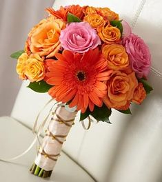 The FTD® New Sunrise™ Bouquet is a dazzling display of floral elegance to help you celebrate your new life together. Orange and fuchsia roses are brought together with orange spray roses and gerbera daisies to captivate with it's bright burst of color. Prom Flowers, Flower Bouquet Wedding, Bridesmaid Bouquet, Send Flowers, Carnation Bouquet, Rose Bouquet, Spring Bouquet, Hand Tied Bouquet, Same Day Flower Delivery