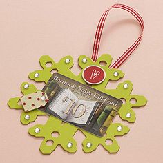 Snowflake Gift Card Holder   Present a gift card with panache using just a few scrapbook supplies. Embellish a chipboard snowflake from a scrapbook or crafts stores with stickers and miniature rhinestones. Attach a gift card to the center with repositionable adhesive. To hang on a Christmas tree, glue a looped ribbon to the back