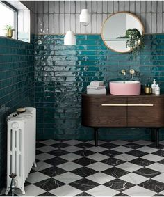 eclectic boho bathroom with teal glazed wall tiles in metro brick tile layout. Mid century modern wash basin with pink sink and gold basin taps. Black and white floor tiles and a victorian radiator completes the look Kitchen Tiles Design, Bathroom Tile Designs, Bathroom Interior Design, Toilet Tiles Design, Bathroom Ideas, Bathroom Hacks, Bathroom Trends, Interior Modern, Kitchen Backsplash