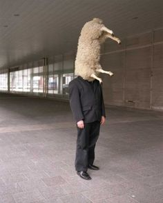 Helmut Dick - The sheep prosthesis (performance) Trade show Art In Rotterdam, the Netherlands, 2006 photography: Jurgen Huiskes, Akiem Helmling